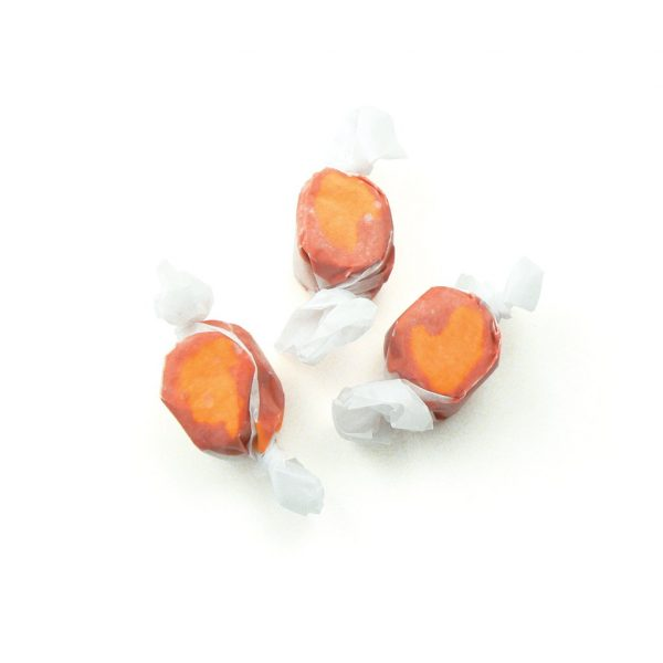 mango taffy salt water taffy orange and red candy three pieces