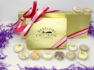 white chocolate assortment in gold box with ribbon