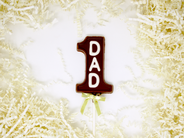 chocolate lollipop shaped like 1 with dad in white chocolate lettering
